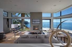 modern beach house living. view in gallery living room with glass walls modern beach house