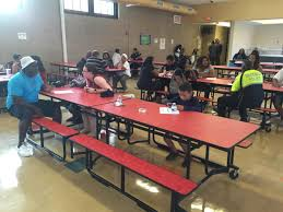 school lunch table. In The Burgard High School Cafeteria, Residents Sit Down With Police For \ Lunch Table