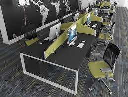 office desks with white closed legs and black table tops and pale green desk screens and