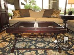 beautiful dark wood coffee table with two lift off trays love the trays on coffee tables
