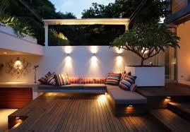 outdoor garden decor. wooden deck and striped toss pillows using amazing track lighting for modern garden decor outdoor