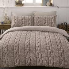warm duvet covers with cream paisley fabric combined with square pillows and small desk