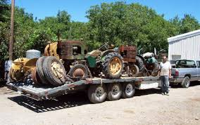 rusty acres ranch we ended up buying the la s in the above photo here are five john deere la s and two luc engines all on one trailerload