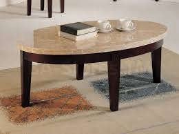 splendid oval cream marble top coffee table set with black wooden legs on stylish cream carpet with unique motif