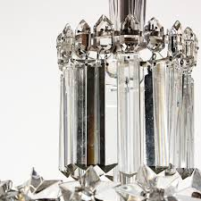 incredible antique three tier four light crystal chandelier dating from the early 1900s this tiered chandelier begins with a simple silver plate canopy