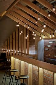 Simple and elegant lighting in the attic bar