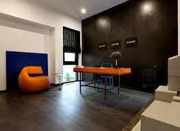 office matte black walls vibrant orange blue furniture blue office walls
