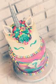 unicorn rainbow ercream tiered cake