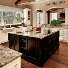 Tuscan Kitchen Style Using Granite Countertops And Induction Cooktop Over  White Cabinets And Dark Brown Island