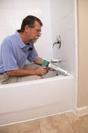 whether the walls around your tub are tile laminate paneling or wallpapered drywall there should be a waterproof seam between the top edge of the tub