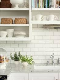 kitchen close up backsplash white subway tiles dark grey grout open shelving shelves marble countertops cabinets tile s75 cabinets