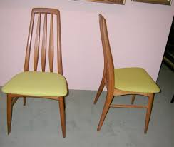 set of four danish modern dining room chairs in polished teak wood having tall backs
