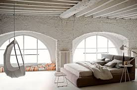 view in gallery spacious bedroom with white brick walls and unique decor design usona