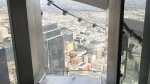 oue skyspace skyslide is at the top of the u s bank building in downtown los angeles 1 000 feet above the streets of downtown it lets brave riders slide