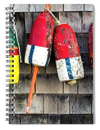 cape spiral notebook featuring the photograph lobster buoys on shingle wall for antique wooden