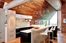 mid century modern kitchen design with wood ceiling and unique stools splus track lighting also black cabinets and sloping ceiling