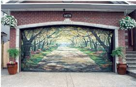 a red brick home has a garage door that has been painted to look like a