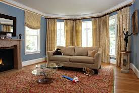 image by designing solutions brown and tan rug bath rugs leather couch living room traditional with area baseboards blue