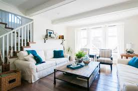 teal pillows pop in white living room