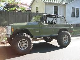 69 jeepster build pirate4x4 com 4x4 and off road 72 was the bull nose grill but on yours it s the same legnth as the early cj5s so push the front axle out and run it or switch to a later cj hood