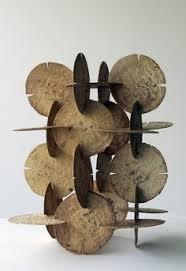 intersecting planes sculpture. nicecollection: damian ortega - modulo de construccion tortillas, 1998. intersecting planes sculpture
