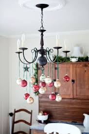 how to decorate a chandelier take champagne and red ornaments and hang them on green twine how to decorate a chandelier