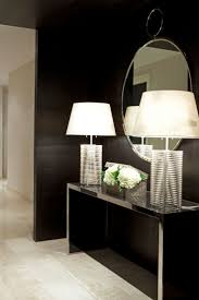 Love the idea of a thin hall table with lighting and a large mirror behind  the