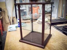 handmade peruvian walnut display case with adjule shelves and glass sliding door