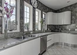 modern kitchen with andino white granite counters white cabinets and gray backsplash tile