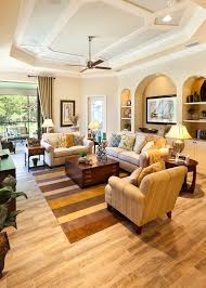 john paras furniture for a traditional living room with a beige sofa and the caaren by john cannon homes