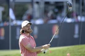 tommy fleetwood of england watches his tee shot on the 18th hole during the