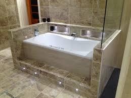 lighting a bathroom. Tiled Whirlpool Bath Housing With Niche And Plinth Lighting A Bathroom