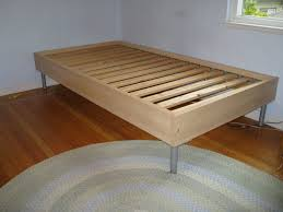 Simple Wooden Ikea Twin Size Bed Frame With Metal Legs On Braided ...