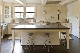 cream kitchen island with black countertop