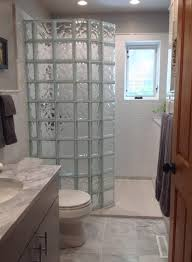 a tub to glass block walk in shower conversion with a curved glass wall innovate