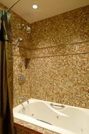 relaxing tub with glass mosaic tile surround