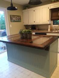 kitchen island made from barn door it conceals our 3 dogs crates and