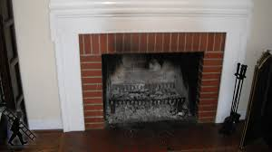 renovating a fireplace by installing a wood stove insert