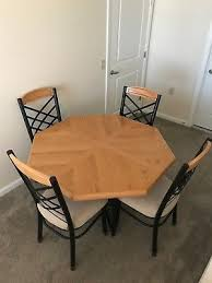 dining table with four chairs wood and metal frame 48 x 48