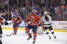 charlottetown s josh currie celebrates a goal with the american hockey league s bakersfield condors in this file