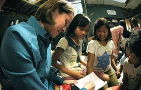 u s department of > photos > photo essays > essay view u s navy lt j g melissa gonzales plays n children at the murni jaya orphanage