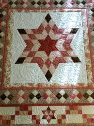 Six-Pointed Star Is Off The Frame   Catbird Quilt Studio & You can see in both of them that the wool, especially in the center, gives  a lot of stitch definition and texture. Adamdwight.com