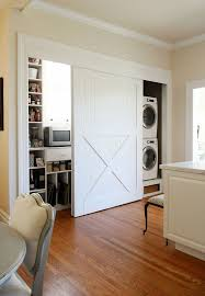 entryway office barn door. View In Gallery White Barn Doors To Hide Laundry Appliances And Other  Storage Entryway Office Door