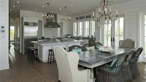 zinc dining table magnificent beach cottage kitchen with crystal chandelier over whitewashed room 60 round