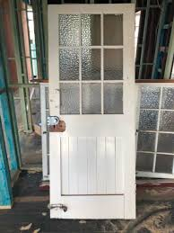external front door with glass panels and vj section