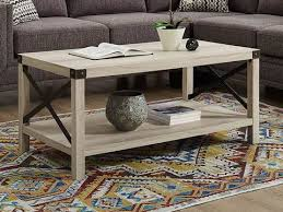 This set includes a dining table and four cross back dining chairs, boasting a versatile, contemporary design. Coffee Tables Walker Edison