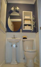 cute and small powder room ideas for space saving design ideas sweet wall mounted oval mirror over white porcelain pedestal sink and toilet as