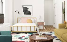Studio apartment furniture layout Person Metal Bed With Wood Nightstand On Right Floor Lamp On Left Architectural Digest Found Two Great Studio Apartment Layouts Architectural Digest
