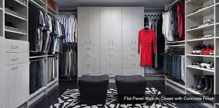 flat panel walk in closet with concrete finish