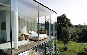 Bedroom with a floor-to-ceiling glass wall